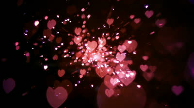 stock-footage-pink-heart-confetti-and-sparks-in-slow-motion